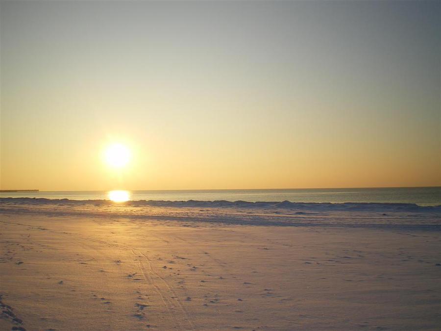 Snowy beach by Astrazzz