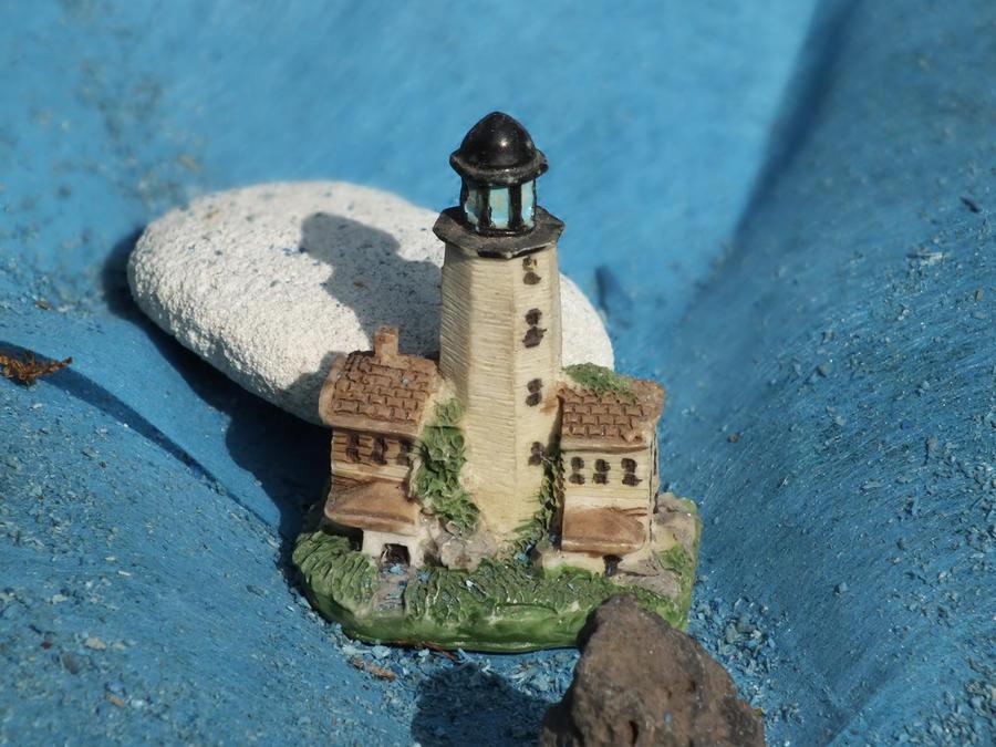 Small Lighthouse Between Rocks