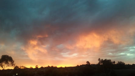 sunset after a storm 3 by heilo