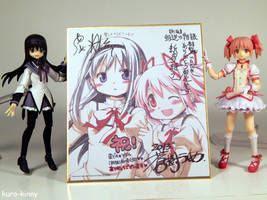 Rebellion Autograph Thing with Homura and Madoka by Kuro-Kinny