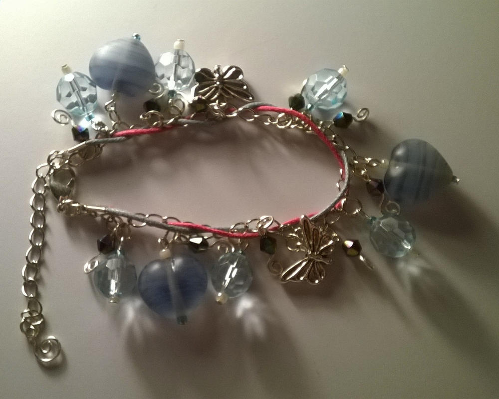 Blue heart and butterfly bracelet (handmade) by GyptianDragonRider