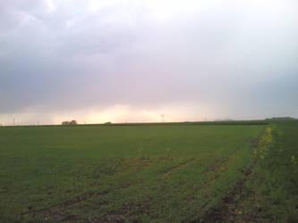Rainlights behind a field by Oracions