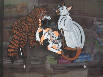 The Clinic Window Painted Cats