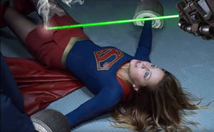 Supergirl vs the kryptonite laser by Tormentor-X