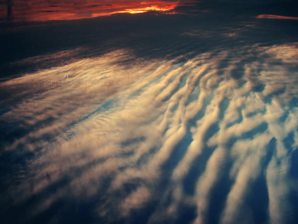 Surfing Sky by Kostandina