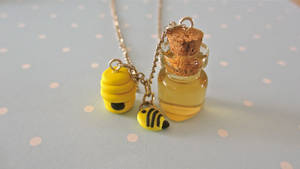 Miniature honey beehive and bee necklace