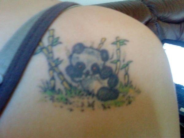 Fixed-up panda tattoo by .