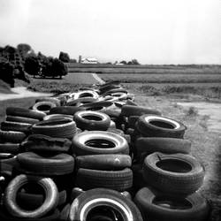 old tires and farm by cedmundmiller