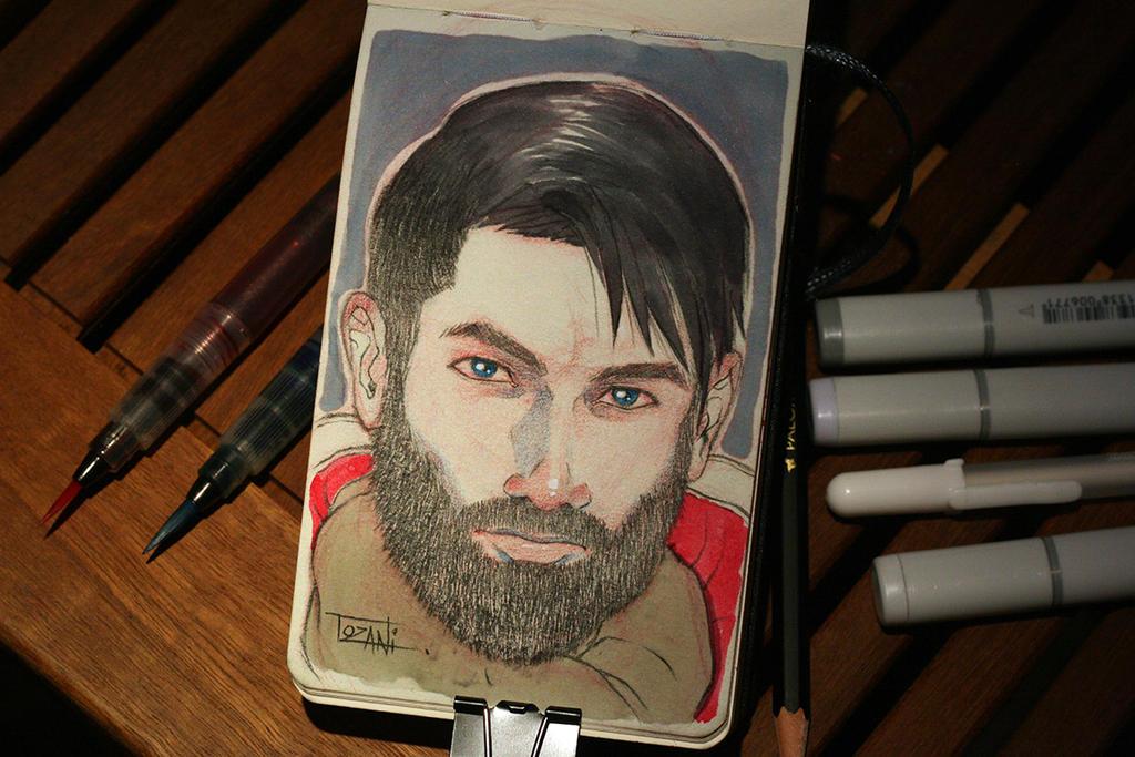 Bearded guy in restaurant by Tozani