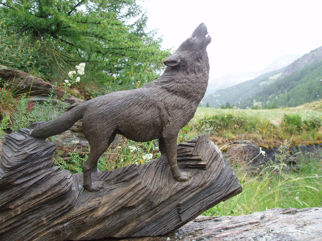 Woodcarver wolf howling in bog oak by woodcarve on
