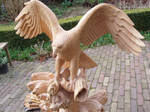 Woodcarver Eagle with salmon in progress 17