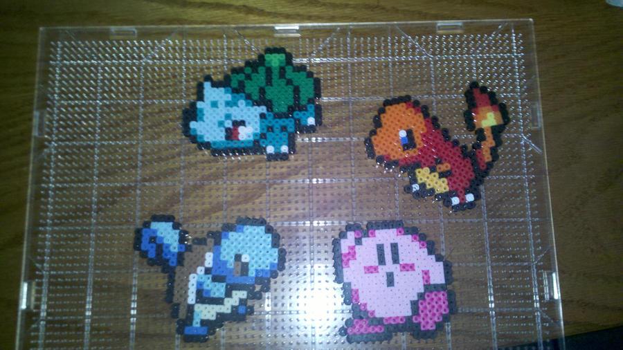 Starter Pokemon and Kirby by darkprincesschic