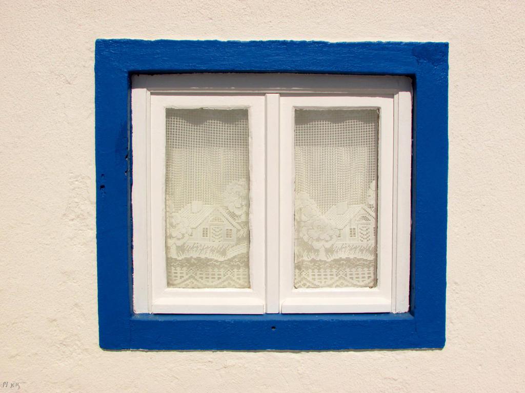 Blue framed window by Boias