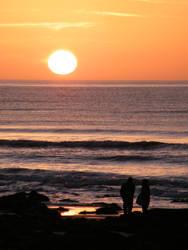 Llandanwg Sunset couple by VampireBait