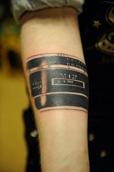 My Nikon 85mm Tattoo by Utilikiltarian