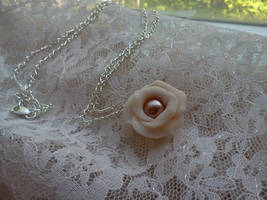 Pink flower charm necklace by eyescoveredhazel