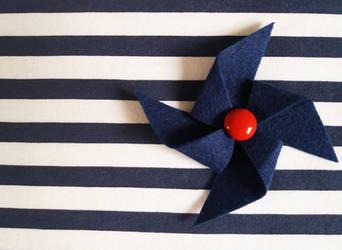 Navy pinwheel brooch
