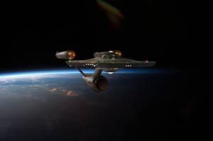 Restored Starship Enterprise Model Over Earth by Cannikin1701