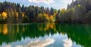 Sunny day. Reflection. River. Autumn at Turkey.