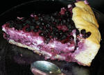 Blueberry-white chocolate-quark pie slice