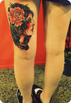 girl tattoo on thigh
