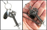 silver and hematite key