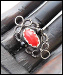 red and black ring