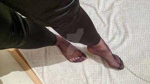 Tasty feet in tights and leather leggings