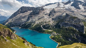 Fedaia Pass with lake at the foot of Marmolada