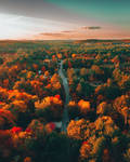 Golden hour drone shot of Cobbetts Pond Road looki