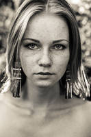 Freckled girl with long earrings by RadoslawSass