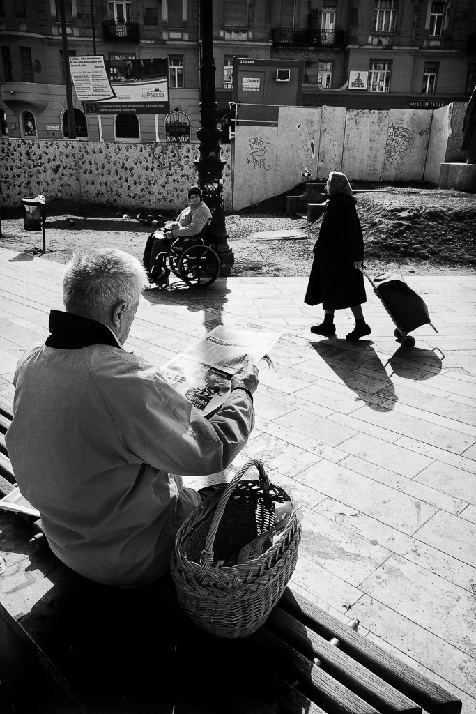 The beggar, the shopper and reading the news by sandas04