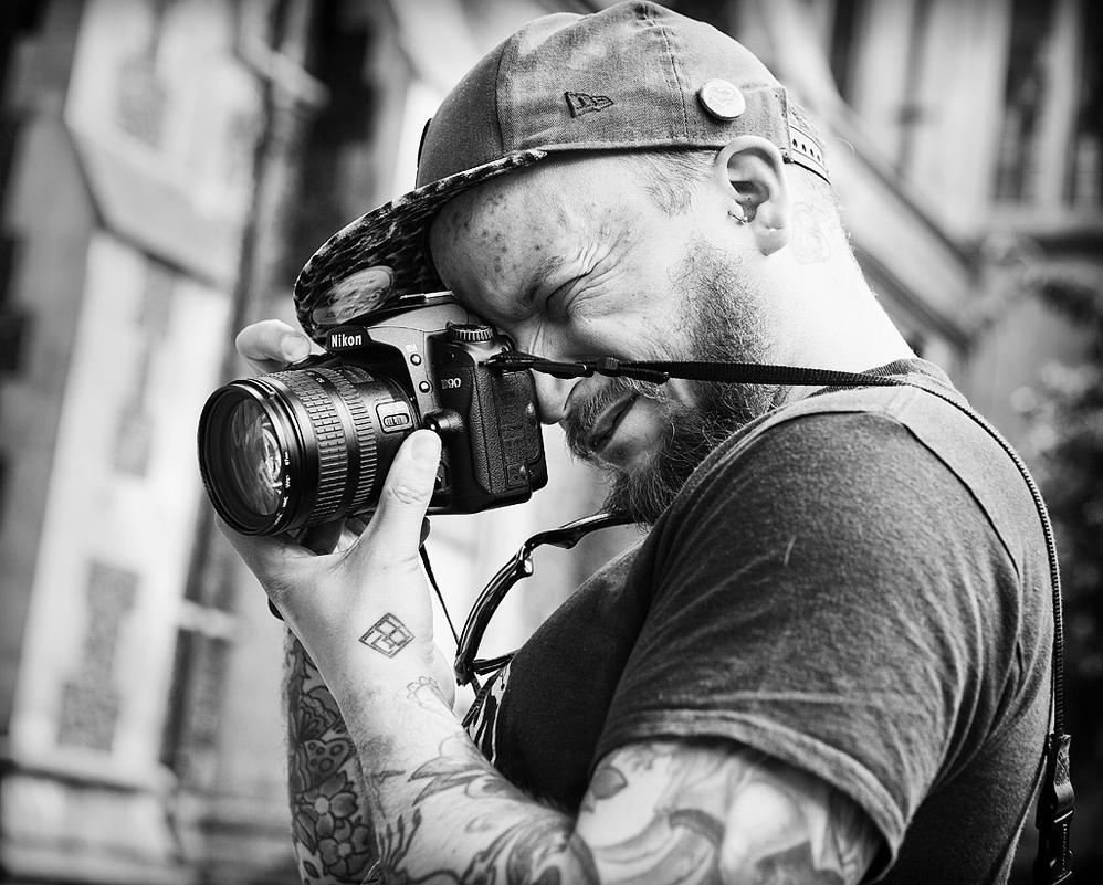 Die Hard Photographer by sandas04