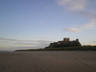 Moon over Bamburgh Castle by mr-macd