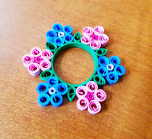 Quilled ring of flowers by DressToQuill