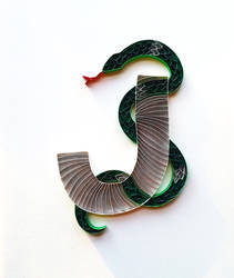 Paper quilled card: J with snake wrapped around it