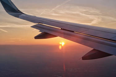 Airplane Sunset View by h3design