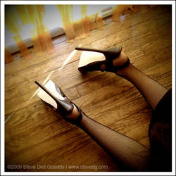 Heels Worn Against Wooden Floo