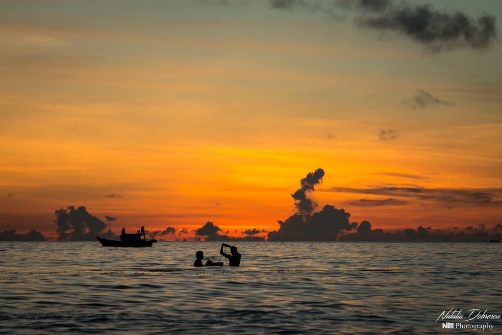 Fishing at sunset by mydarkeyes