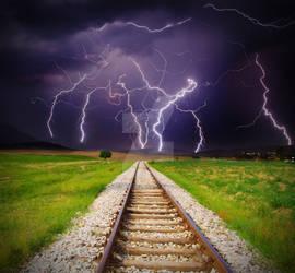 Lightning storm over railroad