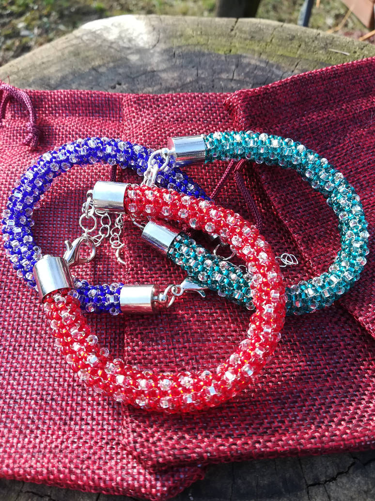 Stackable bracelets in matching colors by Naidiriv