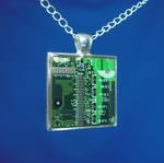 Circuit Board Pendant: Green City Sunrise by Llyzabeth