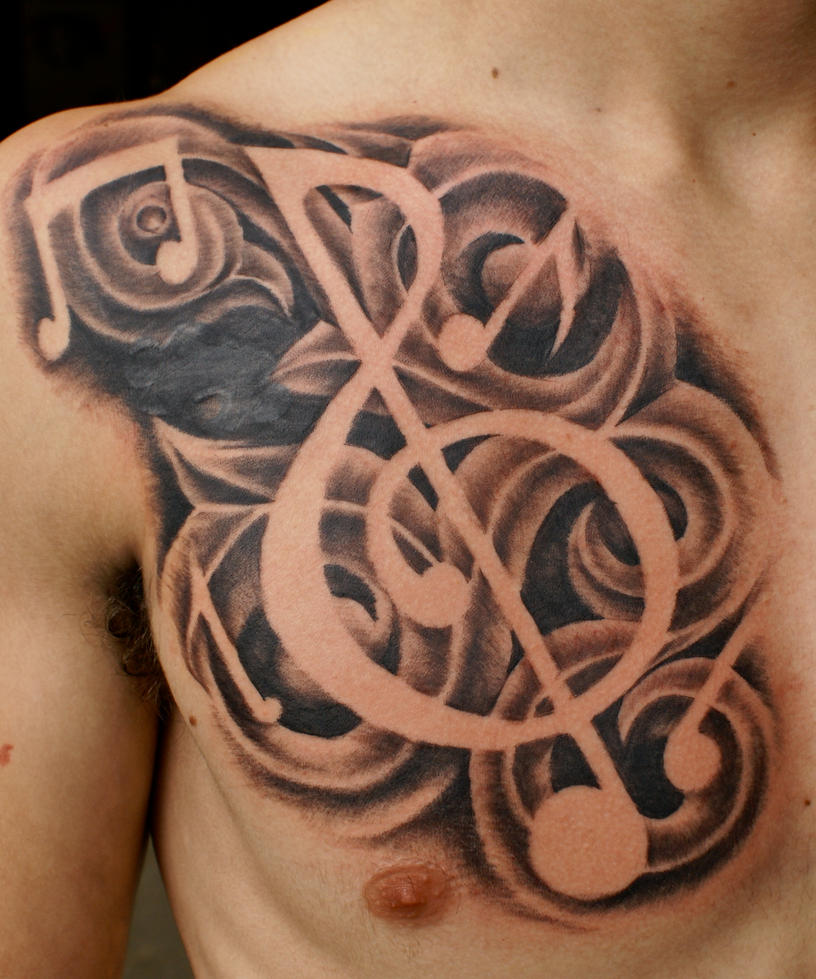 freehand music tattoo by