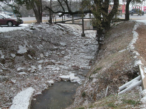 Snow In The Creek