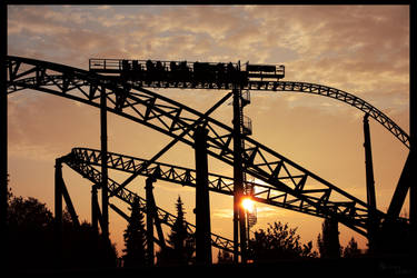 A rollercoaster in the sunset by Nadine2390