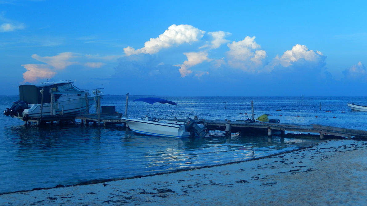 Small boats at the sea by Seigner