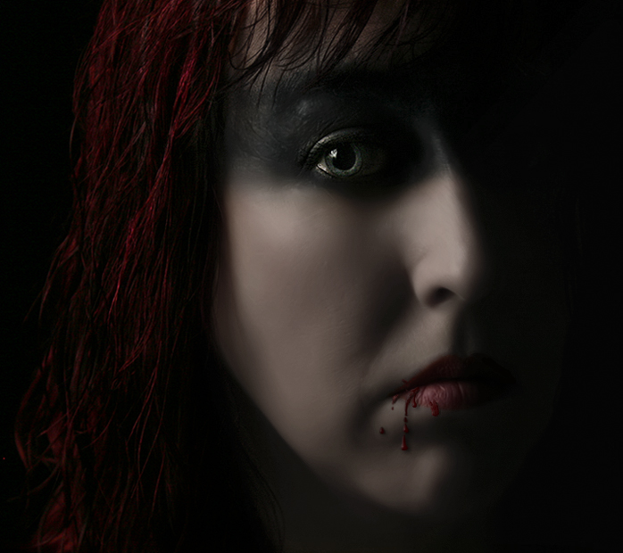 IMAGE: http://fc07.deviantart.com/fs25/f/2008/138/7/c/Vampire_reworked___light_eye_by_AngiNelson.jpg