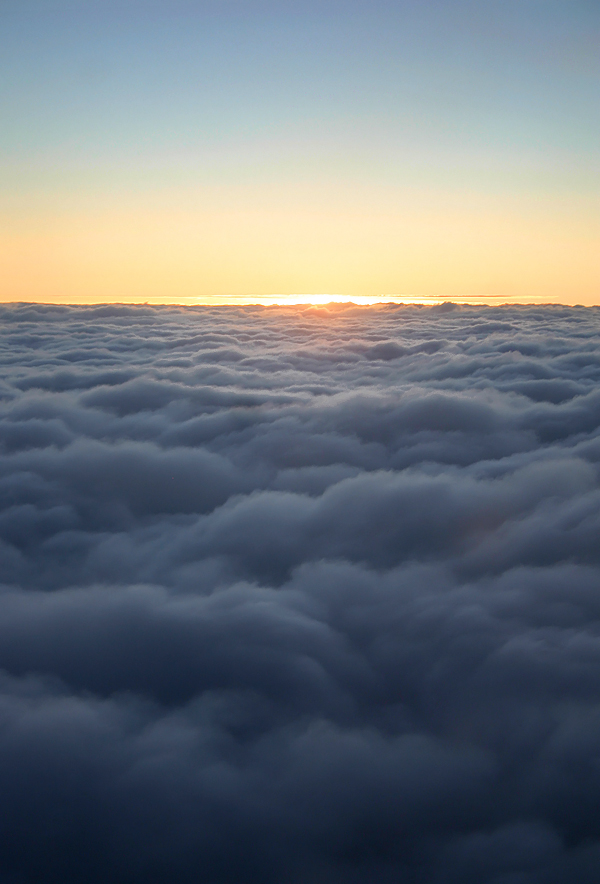 Sunrise over clouds stock by AngiWallace