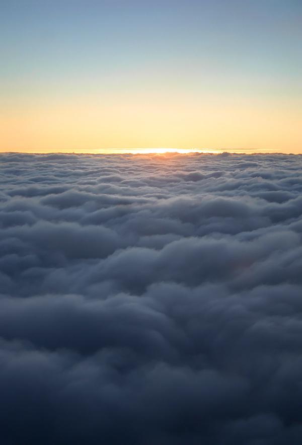 Sunrise over clouds stock