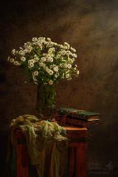 Wild flower still life with books